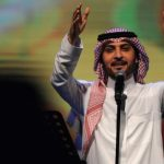 Saudi Arabia arrests woman for hugging singer